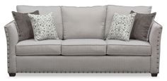 Built to Last. Make a grand statement with the Mckenna sofa that exudes classic appeal. With its comfortable seating, this furniture features oversized nailhead trim adorning the ever-stylish flared arms. Complemented beautifully by patterned and contrast-colored accent pillows, the relaxing gray  fabric is versatile and will match any décor.