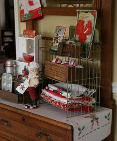 Consider doing something like this in the kitchen....Put away the appliances and display the pretty things instead! Tea towels, rolling pin, dishes, cookie cutters, baking pans....vintage baking display - cute idea for a Hoosier cupboard