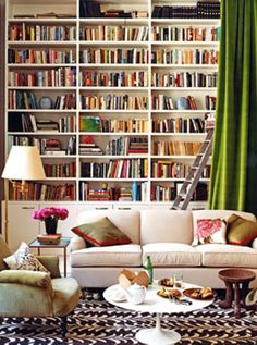 I have an odd addiction to books (you may catch me inhaling the inside of a book, stroking pages, or flipping a page back and forth just to listen to the sound it makes). A wall to wall bookshelf is an absolute MUST!