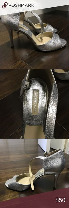 Michael Kors silver sandals Bought at Saks Oulet for 150.00. Some scuffing on the bottom of the shoes but overall great condition. Size 9. Great for a dress or jeans! Shoes Sandals