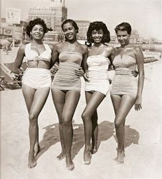 Beach bunnies decked out in retro bathing suit styles.