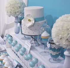 Blue cake, cupcakes, & pops. So cute for a baby shower!