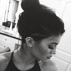 Kylie Jenner's industrial, helix, rook and daith  piercings.