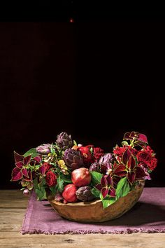 Dark and Dramatic | Austin, Texas-based floral designer Elizabeth Lewis reimagines Christmas bouquets with bolder colors and shapelier silhouettes. Reimagine your Christmas spread with elegant, bold, punchy, and cheery holiday flower arrangements. We know large, ornate Christmas centerpieces can seem involved and well, daunting. But Austin, Texas-based floral designer Elizabeth Lewis gave us some fresh ideas and even better, they come with step-by-step instructions.