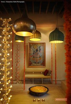 big hanging lights, God's painting, small lights in Puja room