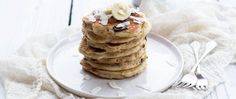 Coconut, bananas and dark chocolate are added to Bisquick Heart Smart Mix for these yummy pancakes topped with coconut honey syrup.