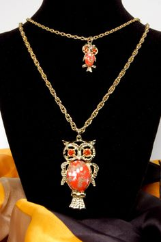 1970s Retro Groovy Double Owl Necklace with Orange Eyes, Gold,Coral, White Body Gold Tone Chain Mother/Child Necklace. $16.00, via Etsy.