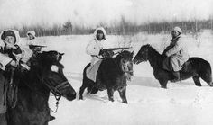 Soviet mounted troops, wearing snow camouflage, on the Don River front, 26 December 1942.