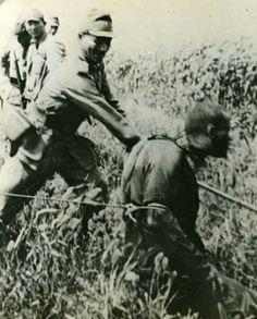 Typical Japanese Army brutality... summary beheading of a POW.