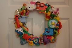 This Adorable Toy Wreath Is Just TOO Easy - http://www.wisediy.com/this-adorable-toy-wreath-is-just-too-easy/
