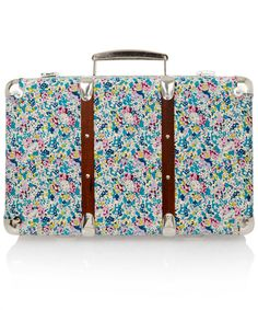 Liberty of London, Claire-Aude Liberty print miniature suitcase, £65.00, tiny blue, yellow, and red florals