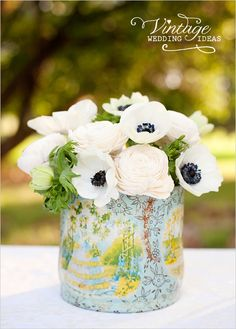 We all know I love tin cans for floral arrangements (think my wedding centerpieces), look how charming!