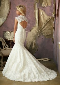Trumpet wedding dress, lace. But without the lace on the shoulders.