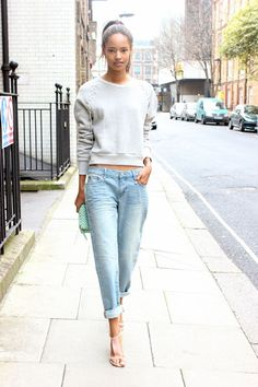 Malaika Firth hits the pavement in a grey sweatshirt and rolled boyfriend jeans. #Offduty #London