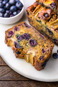 HOLY YUM! This Healthy Blueberry Banana Bread is moist, flavorful, and so delicious. Can't believe it's made with good-for-you ingredients.