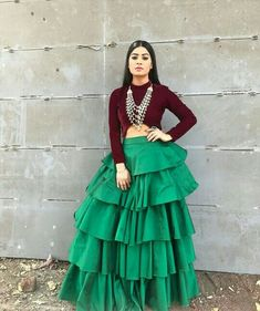 Image may contain: 1 person, standing Choli Designs, Saree Blouse Designs, Dress Designs, Indian Dresses, Indian Outfits, Western Dresses For Women, Crop Top Dress, Indian Designer Wear, Indian Wear