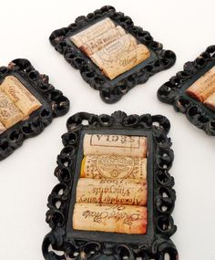 old picture frames, antiqued with flat black paint and paired with halved wine corks = sexy chic coasters