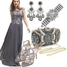 Il grigio è un colore elegante e versatile, lo dimostra questo outfit. Il grigio enfatizza i ricami del vestito e la leggerezza della lunghezza. Gli accessori sono ton sur ton per un risultato di gran classe!