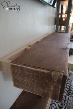 Building floating shelves http://www.shanty-2-chic.com/2014/11/diy-media-shelves.html