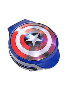 """<p>Start your mornings off right with the help of everyone's favorite patriotic superhero, Captain America! The Marvel icon has jumped off the comic book page and into your kitchen to help create a slew of delicious, sweet treats the entire family can enjoy. This waffle iron makes one large Captain America shield waffle and is perfect for any superhero-at-heart!</p>  <ul> <li>Makes one 7"""" diameter waffle</li> <li>Plastic housing; non-stick metal plates</li> <li>760 watts</li> <li>I..."""