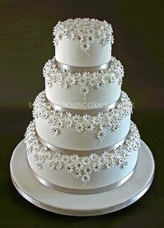 Stunning! Silver and White Daisy Wedding Cakes