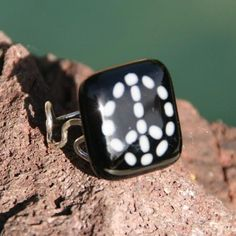 Bits of Peace - White on Black by Cocoon. American Made. See the designer's work at the 2015 American Made Show, Washington DC. January 16-19, 2015. americanmadeshow.com #ring, #jewelry, #fusedglass, #americanmade, #peace