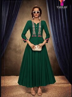 Add the feel of feminine elegance by this green rayon party wear kurti. The ethnic embroidered work over a attire adds a sign of elegance statement with your look. (Slight variation in color, fabric &. Anarkali Kurti, Long Anarkali, Salwar Kameez, Salwar Suits, Kurti Collection, Summer Collection, Indian Gowns, Indian Lehenga, Pakistani Dresses