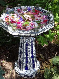 This is a bird bath mosaic I did last winter. The grand-kids did the flower art.