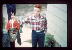 My brother giving me rabbit ears as I clown around at our house in shelby...early 60's.