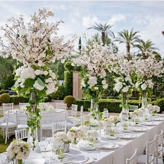 Beautiful oversized floral centerpieces simply yet chic soft tones of ivory & green for this outdoor wedding reception styling #wedding #weddingstyling #eventstyling #outdoorwedding #weddinginspo #gardenwedding #weddingreception #flower #flowers #floral #floralcentrepieces