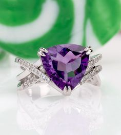 This purple ring is sweet like candy for your soul! Goodies that glow like this are the rock candy we're indulging in these days! | 4.77ct Trillion African Amethyst With .17ctw Round White Topaz Sterling Silver Ring [Promotional Pin]