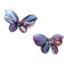 """This is a set of our very popular butterfly beads in the shimmering fumed colors using 22K gold.  Each piece is hand blown out of pyrex (boro) glass, kiln annealed in our Bend, OR studio and fumed with permanent precious metals  Size: Approx 1"""" each."""