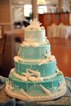 Worked at a wedding once on HHI with a cake like this...But, white buttercream! The shells are white chocolate! Yum!