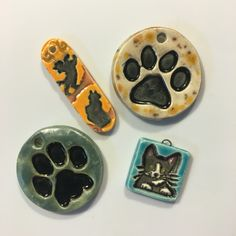 A few kitty-inspired pottery pendants.