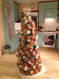 DIY cheap wedding cake using mini muffins on polystyrene cone, DIY croquembouche, cheats croquembouche, alternative wedding croquembouche