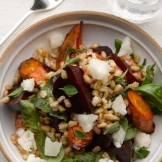 This recipe offers a multitude of textures, as well as intense colours. Whole wheat or freekeh can be substituted for split wheat. Pearl barley is another option: it will save you the overnight soaking and won't take so long to cook. Toasted walnuts give another layer of earthy flavours. Serves four.