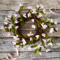 Looking for easy ways to refresh your home decor for spring? Learn how to make this gorgeous plum blossom wreath with blush pink crepe paper