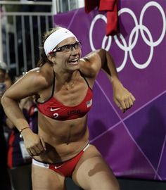 Misty May Treanor reacts after she and teammate Kerri Walsh Jennings beat April Ross and Jennifer Kessy during the women's Gold Medal beach volleyball match between two United States teams at the 2012 Summer Olympics, Wednesday, Aug. 8, 2012, in London. (AP Photo/Dave Martin)