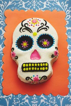 This Day of the Dead Skull Cake is very easy to make and will be the hit of your Dia de los Muertos Party. An inexpensive pan does most of the work and once covered in icing, it becomes a blank canvas for your creative touches. We used punched out fondant flowers and confetti sprinkles to get the folk art look of a Mexican sugar skull, but feel free to use your own inspiration to create a unique cake skull that will get the fiesta started. Our easy to use skull pan requires one box of cake…
