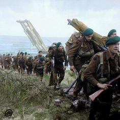 Royal Marine Commandos attached to 3rd Division move inland from Sword Beach on the Normandy coast on June 6, 1944. Thousands of British and US airborne troops parachuted in to  Ranville and St Mère-Église in Normandy