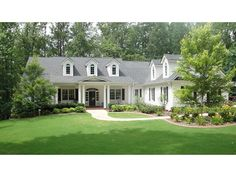 Home Plan HOMEPW11302 is a gorgeous 3190 sq ft, 1 story, 4 bedroom, 3 bathroom plan influenced by  Colonial  style architecture.