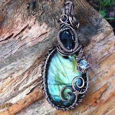 reiki charged labradorite, diamond quartz and blue topaz pendant