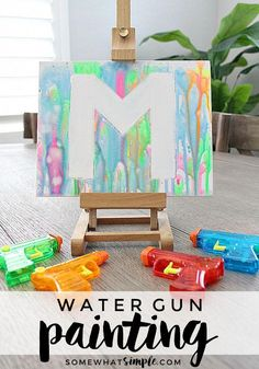 Water Gun Painting If youre looking for some fun inexpensive art projects for kids this summer add painting with water guns to your list Somewhat Simple Summer Crafts For Kids, Summer Activities For Kids, Craft Activities, Art For Kids, Summer Kids, Diy Crafts With Kids, Preschool Summer Crafts, Summer Crafts For Preschoolers, Activies For Kids