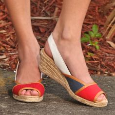 White Mountain Shoes Styling Red, Navy & Tan Wedge eep toe contracting canvas upper working buckle with elasticated expander at ankle strap jute bottom Cement your status as summer style queen and go wild with these statement wedges from White Mountain.
