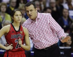 Louisville head coach Jeff Walz and Jude Schimmel (22) talk on the sideline against California in the first half of a national semifinal at the Women's Final Four of the NCAA college basketball tournament, Sunday, April 7, 2013, in New Orleans.