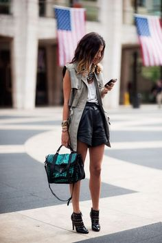 leather shorts, fisherman's vest and statement bag