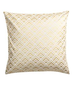 White/gold-colored. Cushion cover in cotton twill with a shimmering, printed pattern. Concealed zip.