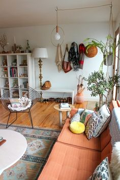 Such a PERFECT space. Eclectic prints, personal wares on display  overall natural, organic feel.