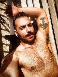 Love his cross tattoo
