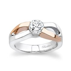 This exotic split shank, two tone gold, solitaire engagement ring sports a low profile round diamond center.  The walls of this cathedral shank create the prongs that channel set the center securely in place.   Rose gold accents trim opposing walls of the shank for an added look of drama. A high polish mirror like finish completes the unique look.  Also available in two-tone, all white, yellow or rose gold, 18k and Platinum.